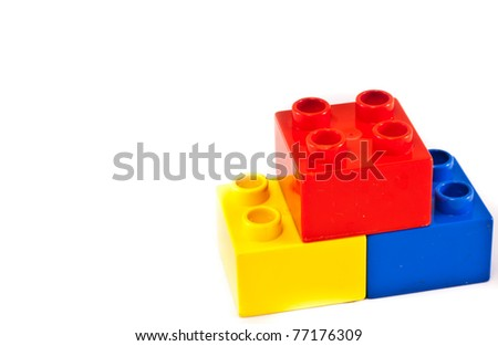 Plastic building blocks on white background. Bright colors.