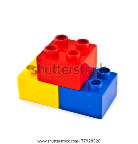 Plastic building blocks on white background. Bright colors. - stock photo