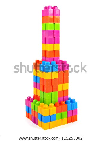plastic building blocks tower on a white background