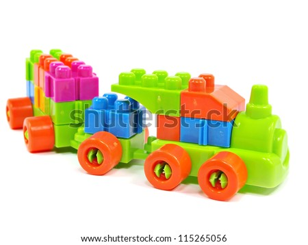 plastic building blocks train on a white background