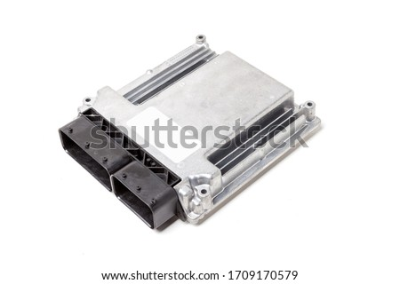 Plastic car engine control unit with metal elements on a white isolated background is the connecting center of various subsystems, units and assemblies. Monitoring the state of the moment. Spare part