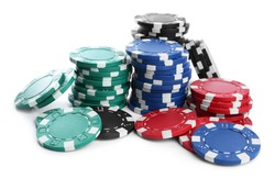 Plastic casino chips stacked on white background. Poker game