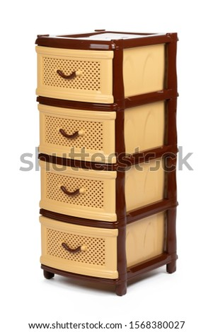 Plastic chest of drawers brown isolated on white background stock photo
