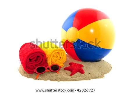 Plastic colorful ball in the sand for on the beach