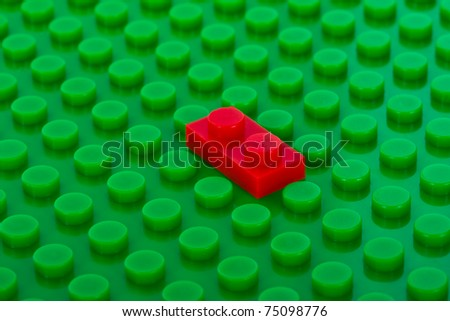 plastic construction background with red brick