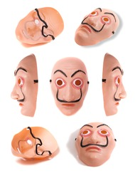 plastic costume face  mask in several angles isolated on a white background.