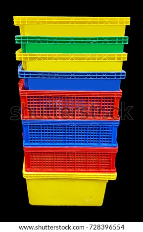 Plastic crates on black background #728396554