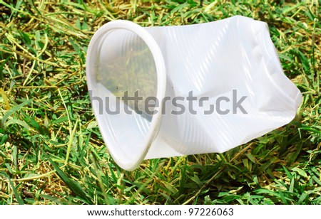 plastic cup on the nature of how the garbage