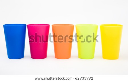 Plastic cups of various color isolated on white.