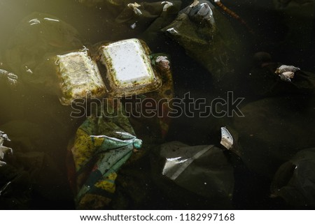 Plastic degradation is Problem of metropolis, Dirty canal with plastic bottle and other garbage are cause of flooding.Thailand #1182997168