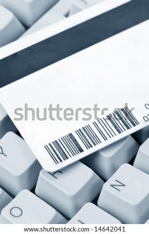 Plastic Digital Data Card and keyboard close up