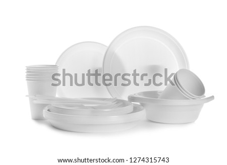 Plastic dishware isolated on white. Picnic table setting #1274315743