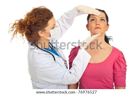 Plastic doctor woman preparing a patient woman for lift surgery isolated on white background