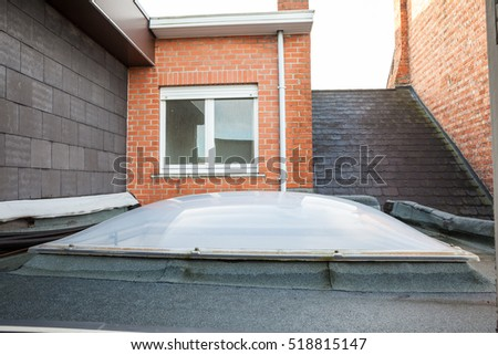 Plastic Dome of a row house on a flat roof #518815147