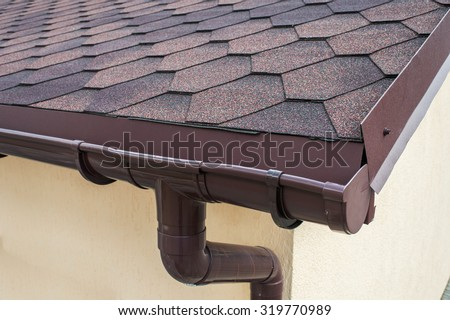 plastic drainage on the roof near the shingles