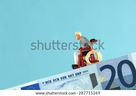 Plastic figurine on banknote