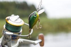 Plastic fishing lure wobbler on the spinning in nature