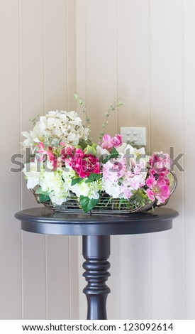 Plastic flowers with modern vase.