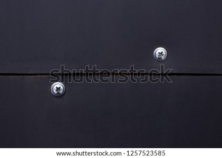 Plastic folias are fastened on a surface by screws