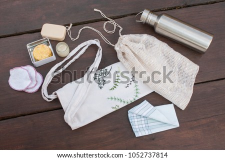 Plastic free, zero waste shopping and living. Reusable, recycled, homemade produce bag for fruit or vegetables, a textile bag, a stainless steel bottle, handkerchief, homemade lavender cream and soap. #1052737814