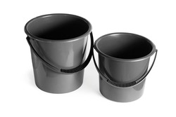 Plastic gray buckets. Close-up. Isolated over white background.