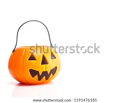 Plastic jack-o-lantern trick or treat on white background With empty space available for Text #1191476185