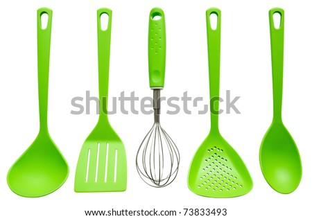 Plastic kitchen utensils isolated on white. Clipping path included.