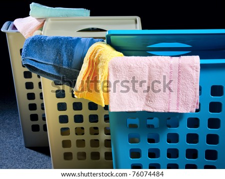 Plastic laundry baskets in different colors