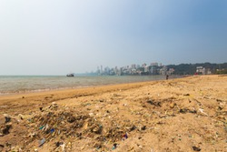 Plastic/littering on Girgaon Chowpatty beach, Mumbai, Maharashtra, India.