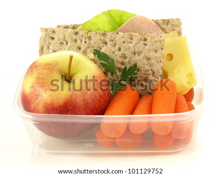 Plastic lunch box with fruits and vegetables