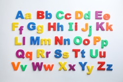 Plastic magnetic letters isolated on white, top view. Alphabetical order