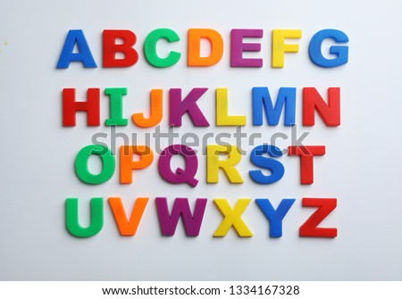 Plastic magnetic letters isolated on white, top view. Alphabetical order #1334167328