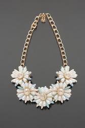 plastic necklace. five beige flower