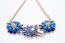 plastic necklace. three blue flower