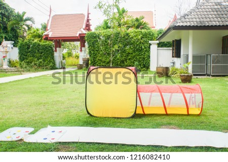 plastic net tube kid toy at outdoor playground at house area #1216082410