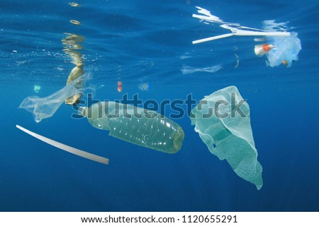 Plastic ocean pollution. Underwater bags, bottles, cups, straws