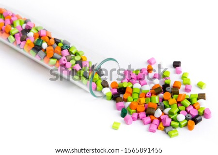 Plastic pallets .Multicolored Plastic granules. Plastic raw materials in granules for industry. Polymeric dye multicolor on a white background. Plastic granules after processing