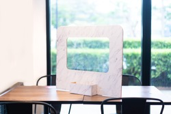 Plastic partition board protect infected from coronavirus covid-19 on the table in restaurant.Social distancing concept.Partition board for separated in restaurant.People,Healthcare,New normal.