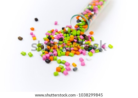 Plastic pellets .Multicolored Plastic granules. Plastic raw materials in granules for industry. Plastic granules after processing of waste polyethylene and polypropylene.Polymer.
