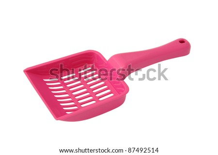 Plastic pink cat sand spoon on white background.