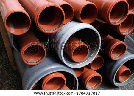 Plastic pipes of different sizes piled up close-up  Stock photo ©