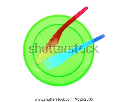 Plastic plates and cutlery over a white background