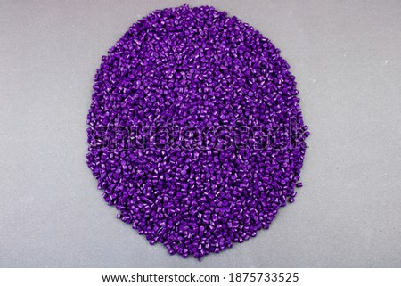 Plastic polymer granules, Color paint that can be used in granular paint plastic and various products Purple colourful! Foto d'archivio ©