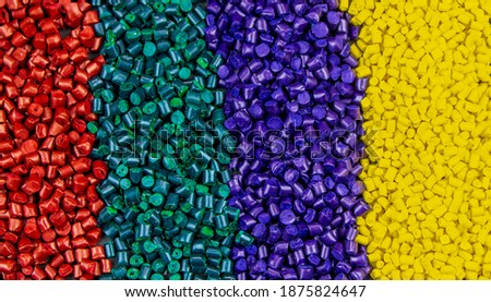 Plastic polymer granules, Color paint that can be used in granular paint plastic and various products Colourful close up! Foto d'archivio ©