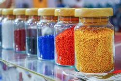 Plastic polymers resin pallet material color full in glass  bottle.