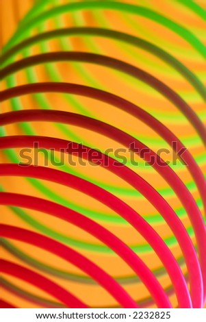 Plastic, rainbow-colored spring toy. Color abstract