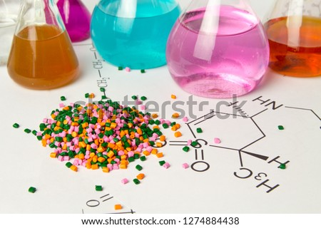Plastic raw material in granules against the background of Chemical Laboratory and reagents. Polypropylene, Ethylene, Polypropylene research in laboratory conditions