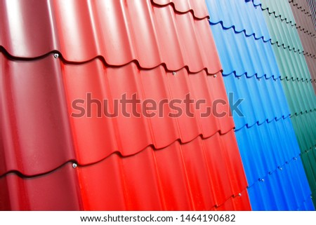 Plastic roof tiles for the house. Fragment of the roof with samples of roofing materials. Trade in building materials.