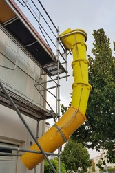 Plastic rubble chute for the safe disposal of rubble and roofing materials from one or more floors..