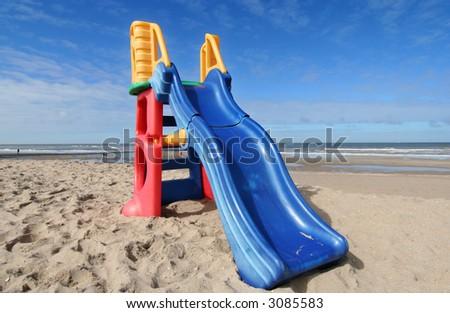 Plastic slide for small children on the beach
